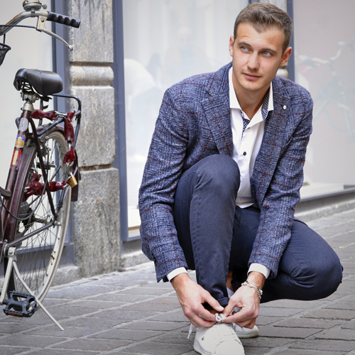 man-next-to-his-bike-wearing-vercini-shirt-veercini-sport-jacket-and-vercini-pants