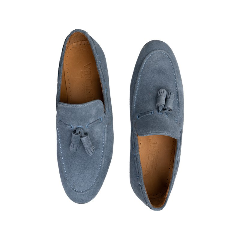 Light blue suede slip on shoes with tassels