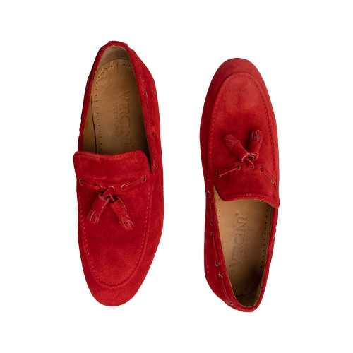 Red suede slip on shoes with tassels